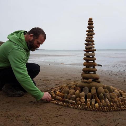 Artist James Brunt on Filey beach - Patricia Morris